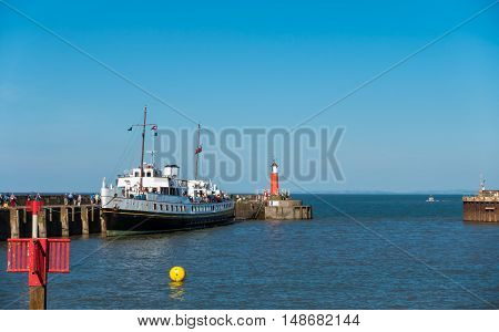 Watchet United Kingdom - August 15 2016: Passengers are walking to board the MV Balmoral ship to continue their Bristol Channel cruise after a one hour stop in Watchet harbour.