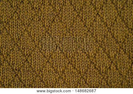 Green knitted yarn as a seamless background