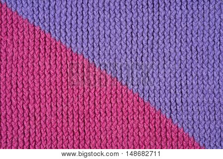 Pink and violet knitting as a seamless background