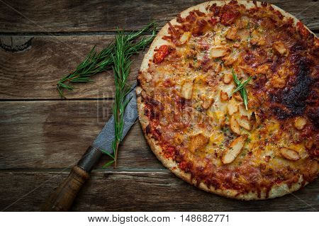Homemade italian pizza with chicken and chili pepper