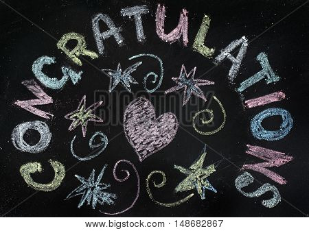 congratulation painted colored chalks on the blackboard / from the heart