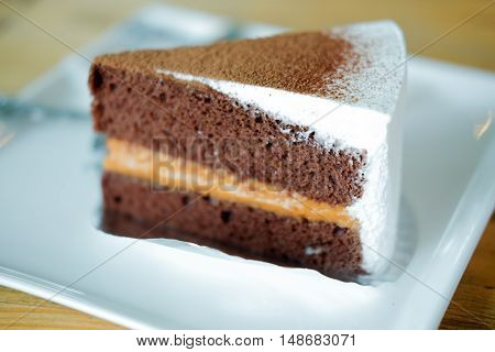 Sliced tasty chocolate and Thai tea cake