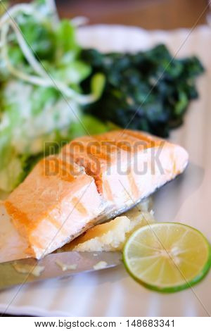 Salmon fish grilled steak and salad, healthy food