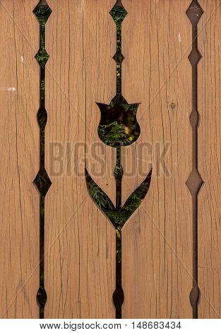 Handmade cutout tulip motive on wooden fence