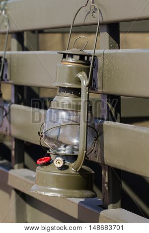 Old green khaki military lamp oil on truck