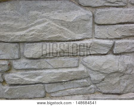 Texture of the grey stone wall. Architectural background