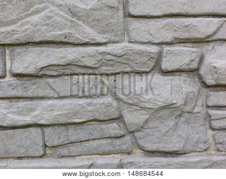 Texture of the grey stone wall. Building background