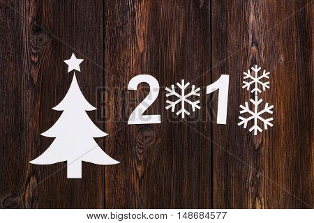 Paper christmas tree with 2018. Wooden background. Abstract conceptual image