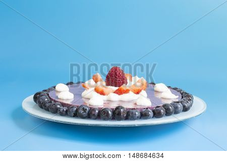 Strawberry and blueberry cake on a plate