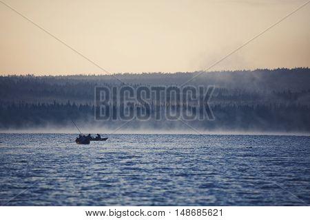 Morning fishing on the lake Zyuratkul. Ural. Russia