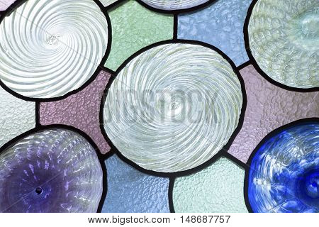 The colorful stained glass circles abstract background