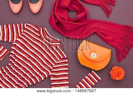 Autumn Fashion woman Clothes Accessories Set. Design fashion. Trendy Scarf Dress, Stylish Handbag Clutch, Glamor fashion Heels, Rose. Top view. Fall Fashion. Outfit. Vintage. Elegant Creative Concept
