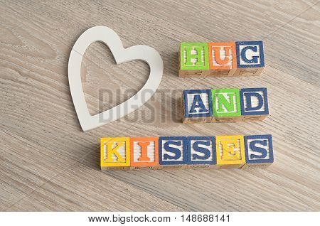 Valentine's Day. Hugs and kisses Spelled with colorful alphabet blocks and a white heart