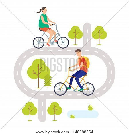 A young man and young woman ride bikes on the road. Cyclists. Cycling.
