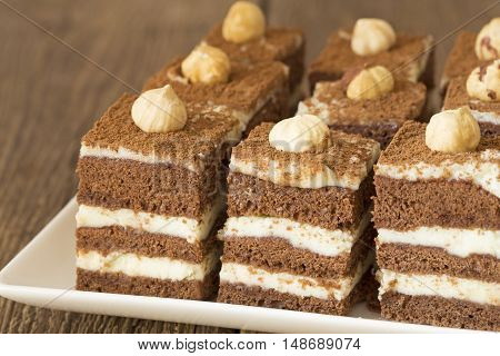 Chocolate cakes with hazelnuts on a plate