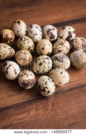 Quail eggs on the wooden vintage table, selective focus