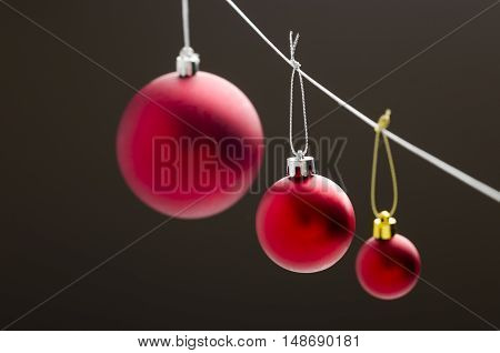Christmas background with a red balls over dark.