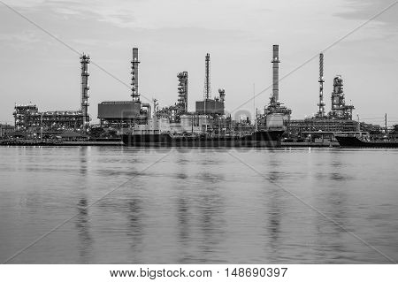 Black and White, petrol refinery river front, industrial background