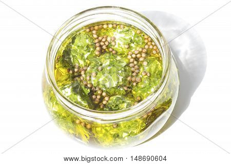 Marinated cheese in a glass jar isolated