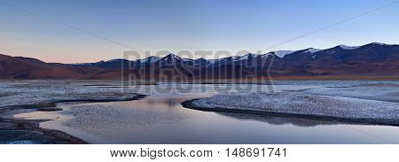 Panorama of Tso Kar salt water lake in Ladakh North India. Tso Kar located in Rupsa valley nearly 240 km southeast of Leh at a height of around 4500 m and is nearly 8 km wide at its widest point and 28 km long