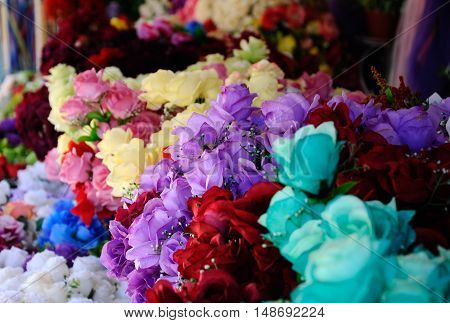 MALACCA, MALAYSIA -NOVEMBER 11, 2014: Artificial flowers made of cloth and plastic are sold to the public. It is made in various types and colors could give the option to the buyer.