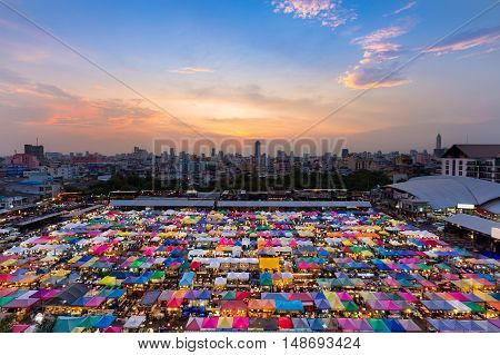 Multiple colours weekend market top view with beautiful sunset sky background