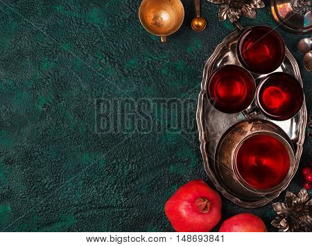 Pomegranates and pomegranate juice on textural background top view with copy space