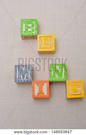 Valentine's Day. Be Mine Spelled with colorful alphabet blocks