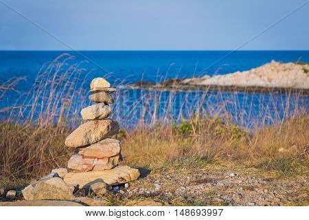 Stone stack over seacoast background, natural abstract background
