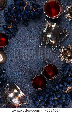 Blue grapes with grape juice or vine top view with copy space