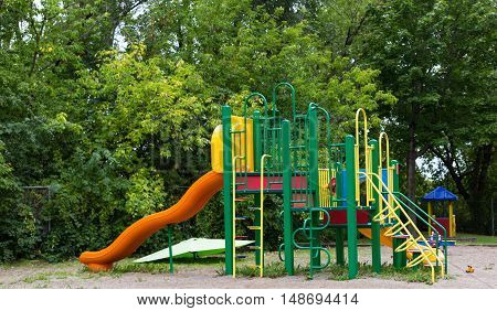 A big colorful children playground equipment with a slide.