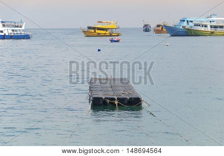 A floating dock off shore on Phiphi Don Island in the Adaman Sea in Thailand.
