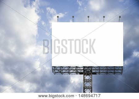 Blank big billboard against blue sky background, for your advertising, put your own text here, isolate white on board