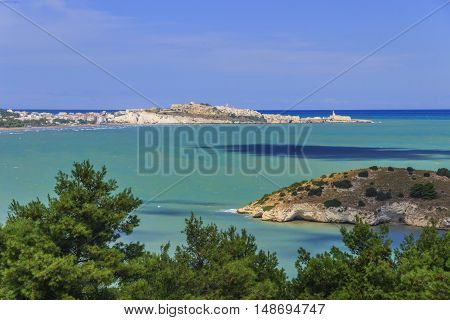 Gargano coast: bay of Vieste.-(Apulia) ITALY-In the foreground the island Gattarella and in the background the town of Vieste.