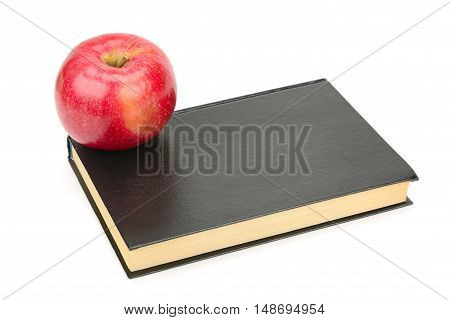 books and apple isolated on white background