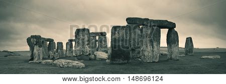 Stonehenge panorama in black and white with cloud near London as the National Heritage site of UK.