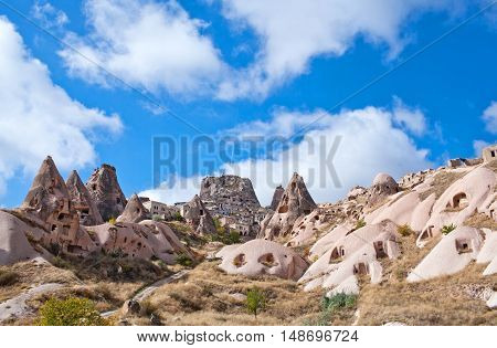 Unique geological formations in Pigeon valley Cappadocia, Central Anatolia, Turkey. Cappadocian Region with its valley, canyon, hills located between the volcanic mountains Erciyes, Melendiz and Hasan.