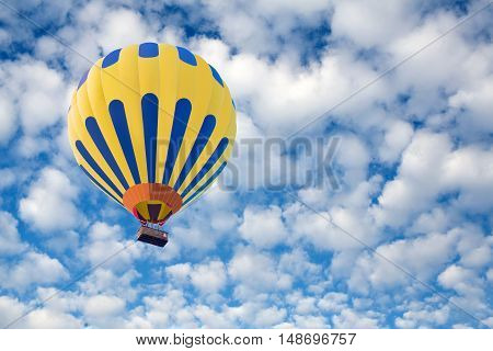 Hot air balloon on the blue sky background