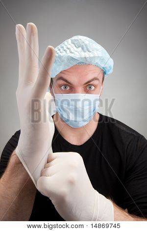 Dark Surgeon Wearing Gloves