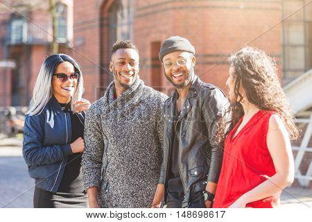 Mixed Race Group Talking In Hamburg