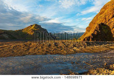 Midnight setting sun lits beautifully volcanic rocks at Thorsmork, Iceland