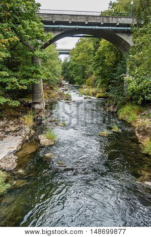 The Tumwater River flows beneath two bridges.