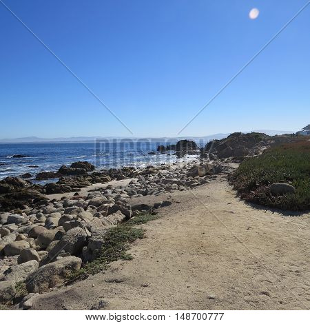 This is a coastal view of Pacific Grove, California on a clear sunny morning .