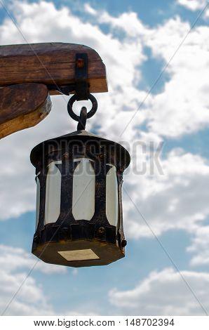 Black metal lantern in the sky. In the historical park