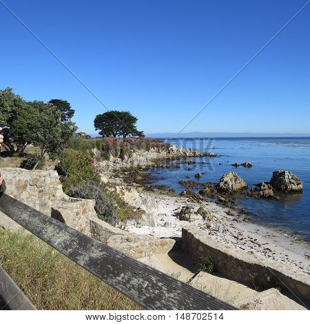 This is an image of a very old cement walk way to the shore in Pacific Grove, California.