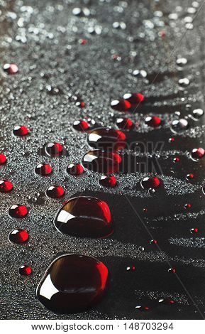 Abstract background with large red drops closeup