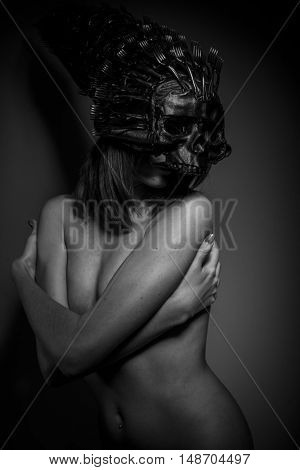 futuristic alien woman naked helmeted skull and metal forks