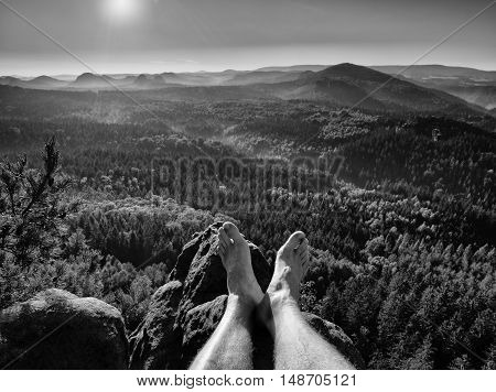 Tired Legs Take Rest On Peak Of Rock. Trip In Hot Summer Weather