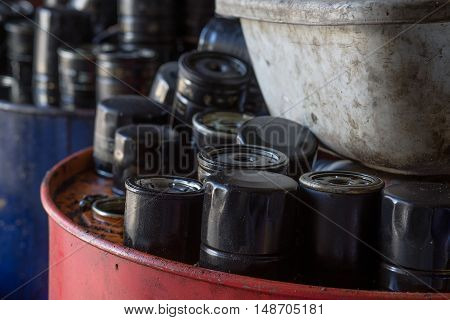 Picture of old and used engine air filters in automotive maintenance service. Closeup picture of old oil filters for automobile. Image made in Kiev, Ukraine.