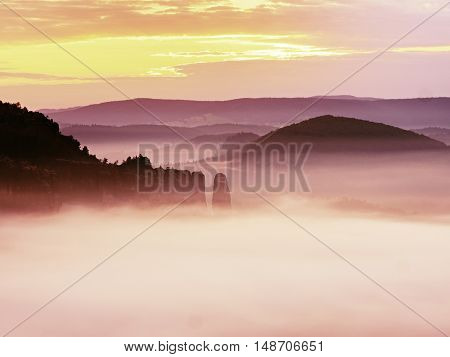 Pink Misty Mountains. Rock Empires  Cut Creamy Fog To Strips. Long Deep Valley
